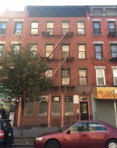 Photograph of 332 East 106th Street building.
